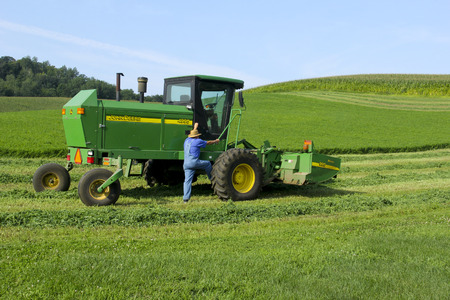 SPENCER , WISCONSIN Sept.11 , 2014: John Deere 4995 Windrower. John Deere Deere and company is an American Coorporation.