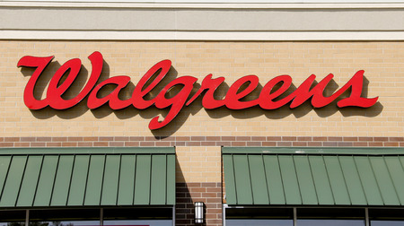 retailing: SPENCER , WISCONSIN Sept.13 , 2014:  Walgreens sign on the store front of the building. Walgreens is the largest Drug retailing chain in the United States.