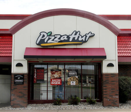 SPENCER , WISCONSIN Sept.14 , 2014: Pizza Hut Sign on a resaurant store front.  Pizza Hut is an American restaurant chain known for Pizza and side dishes. Editöryel