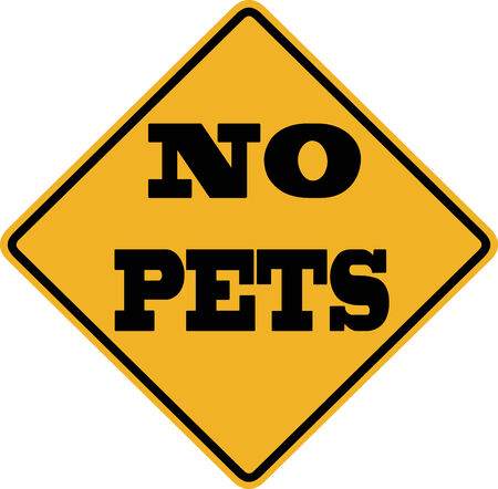 ordinance: No Pets sign with black letters over a yellow background Stock Photo