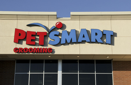 retail chain: SPENCER , WISCONSIN Oct. 8, 2014: Pet Smart Sign on a store front. Pet Smart is a retail chain specializing in pet supplies and services. Editorial
