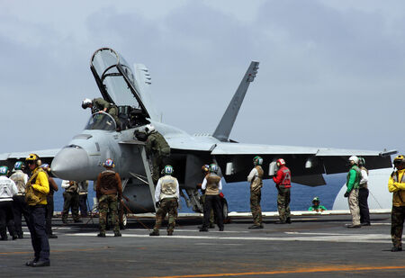 f18: Sea of Japan, Japan, August, 25, 2011,  United States Navy F-18 Super Hornet fighter jet preparing for a carrier launch. Editorial