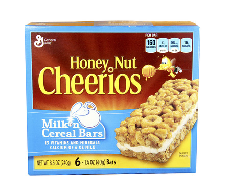 cereal box: SPENCER , WISCONSIN, Dec,16,2014,  Box of Honey Nut Cheerios Milk and Cereal Bars, Honey Nut Cheerios is made by General Mills Inc. Editorial