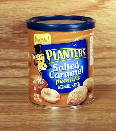 planters: SPENCER , WISCONSIN, Dec,18,2014,  Can of Planters Salted Caramel Peanuts. Planters was founded in 1906