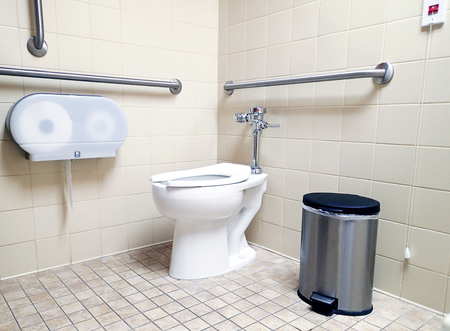 commode: Modern handicapped bathroom for the disabled, with grab bars and wheelchair access.