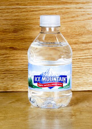 ice mountain: SPENCER , WISCONSIN,January, 27, 2015,  Bottle of Ice Mountain Water. Ice Mountain is a brand of bottled water from the Nestle company.