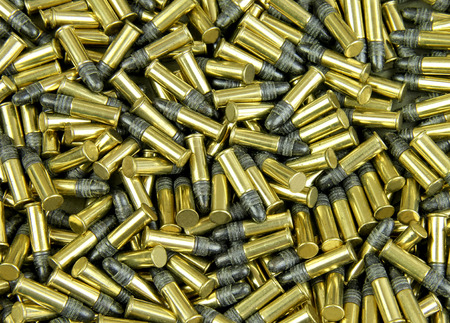 Several Brass cased bullets make a bullet background Фото со стока