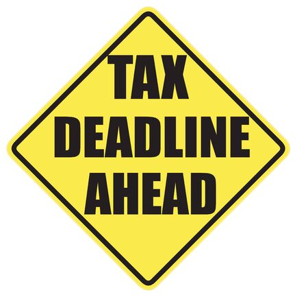 Tax Deadline Ahead warning sign with black letters over a yellow background