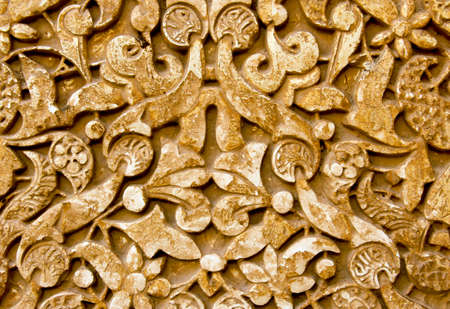 the  alhambra: Wall carving from Alhambra Palace in Granada Spain makes a ruins background