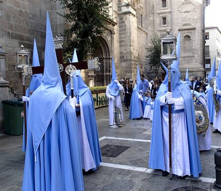 religious clothing: Granada Spain, April, 5, 2015  Easter procession through the streets of Granada Spain