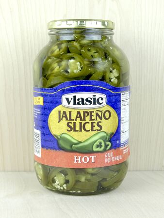 tangy: SPENCER , WISCONSIN, April, 24, 2015   Jar of Vlasic Jalapeno Slices. Vlasic is an American brand owned by Pinnacle Foods and was founded in 1942 Editorial