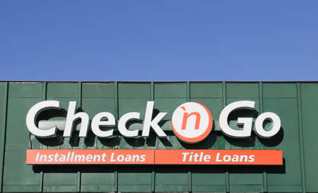 SPENCER , WISCONSIN, September, 28, 2015  Check n Go Sign on a Storefront  Check n Go is a quick cash loan company founded in 1994