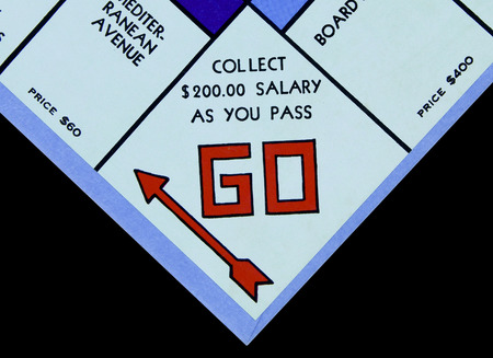 SPENCER , WISCONSIN, November, 6, 2015   Monopoly Board Game GO Square  Monopoly was first introduced by Parker Brothers in 1935 Editöryel