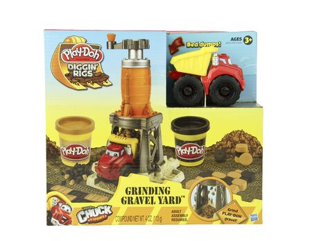 playdoh: SPENCER , WISCONSIN, November, 30, 2015    Box of Play-Doh Diggin Rigs Grinding Gravel Yard kit for children   Play-Doh is now owned by Hasbro and was founded in 1955