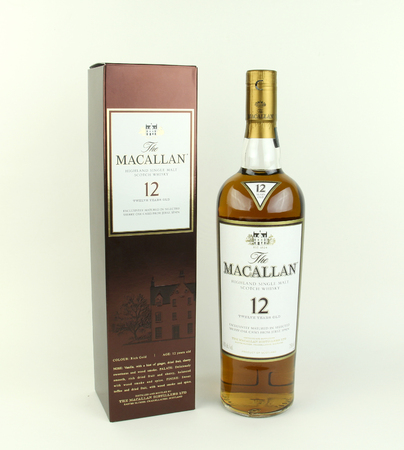 12 year old: SPENCER , WISCONSIN, December,30, 2015    Bottle of  Macallan 12 year old Scotch Whisky and box.   The Macallan Distillery is a single malt distillery in Craigellachie Scotland