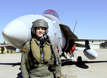 fighter pilot: Fighter Pilot in full flight gear in front of his Fighter Jet Stock Photo