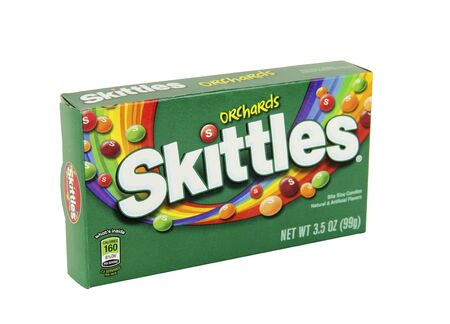 marketed: SPENCER , WISCONSIN, January,28, 2016  Box of Skittles Orchards Candy  Skittles is a brand of fruit flavored candy produced and marketed by the Wrigley Company Editorial