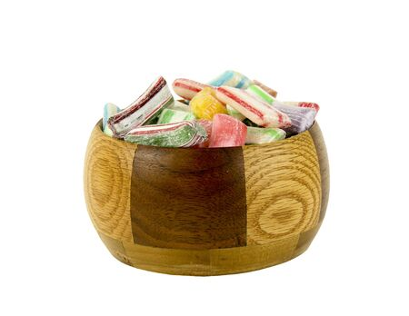 Old Fashioned Hard Candy in a wooden bowl isolated over a white background Фото со стока