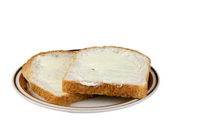 original plate: Two pieces of buttered bread on a serving plate isolated with a clipping path at original size