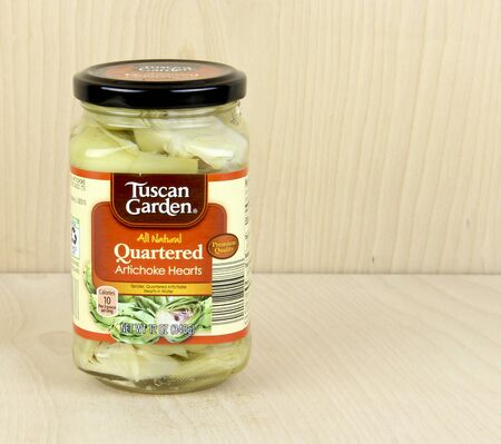 quartered: SPENCER , WISCONSIN, March,6, 2016  Jar of Tuscan Garden Quartered Artichoke hearts   Tuscan Gardens is an Aldi Food inc product Editorial
