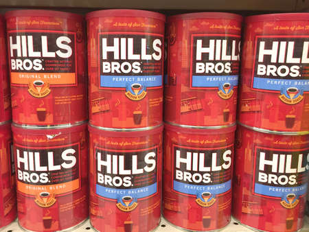 bros: SPENCER , WISCONSIN, March,25, 2016    Several cans of Hills Bros. coffee on a grocery store shelf   Hills Bros. is an American based company founded in 1900