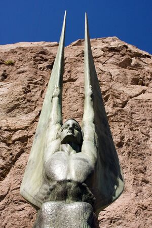 hoover dam: Winged Sculture statue with rock and blue sky in the background at Hoover Dam