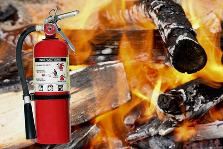 Fire extinguisher with flames and fire as the background