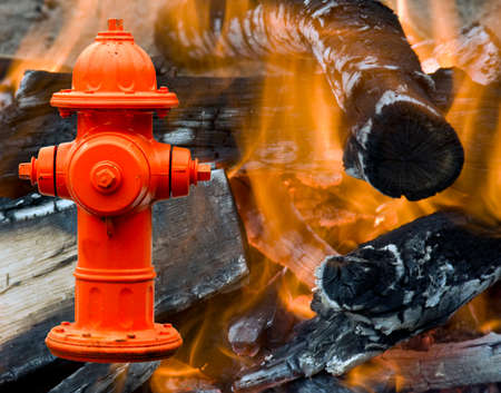 Fire hydrant over flames and burning fire background Stock Photo