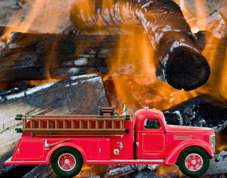 Red Firetruck over a fire and flames background Stock Photo - 58338423