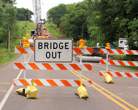 road closed: Road closed with a bridge out sign on a barricade