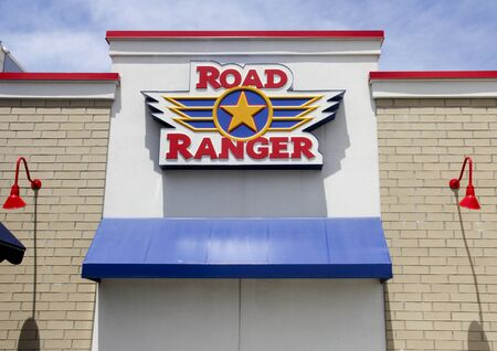 building a chain: Spencer, Wisconsin - July,14,2016  Road Ranger sign on a building entrance  Road Ranger is a Rockford Illinois based chain of travel centers and truck stops