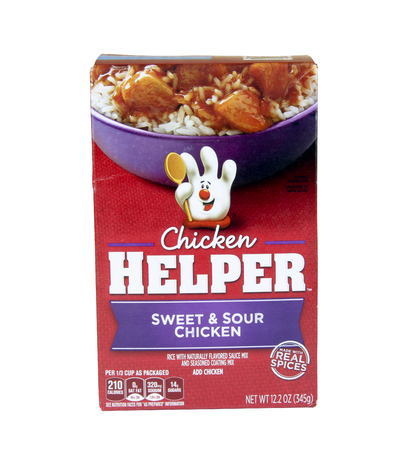 Spencer, Wisconsin - August, 11, 2016    Box of Chicken Helper Sweet & Sour Chicken    Chicken  Helper is a packaged food product branded by General Mills