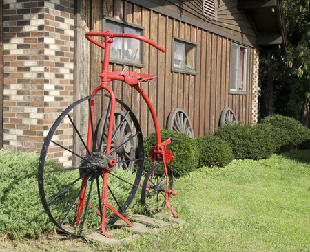 two wheel: Vintage two wheel bicycle used as a lawn decoration