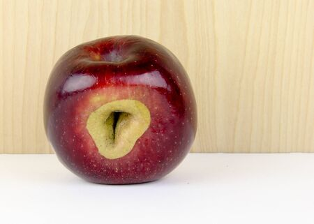 defect: Abnormal apple showing defect in the growth of the fruit Stock Photo