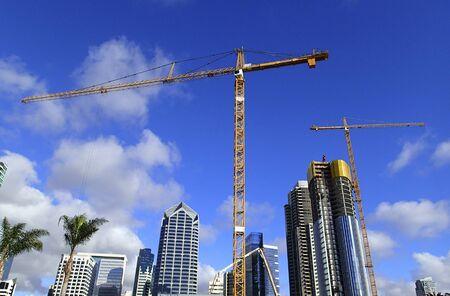 Huge construction cranes for skyscraper construction