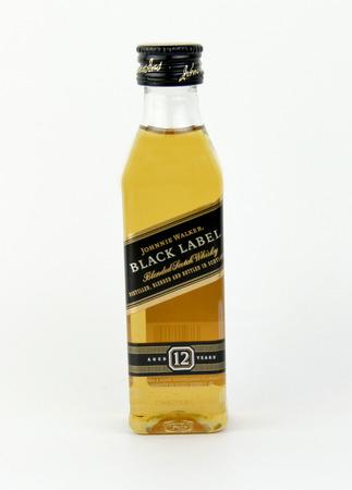 distilled alcohol: Spencer, Wisconsin, January,19,2016,  Mini bottle of Johnny Walker black label Scotch Whiskey  Johnny Walker is a brand of Scotch Whisky owned by Diageo