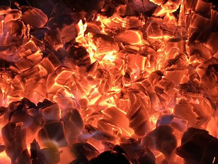 Red hot coals make  fire background Stock Photo