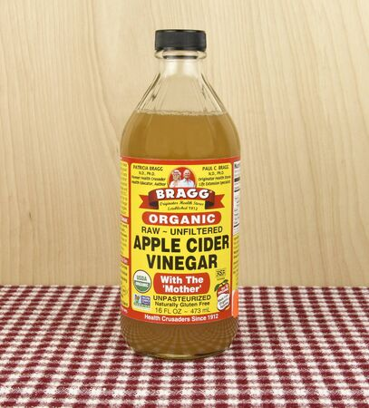 Spencer, Wisconsin, April, 18, 2017    Bottle of Bragg Apple Cider Vinegar   Bragg is an American based company founded in 1912 Editorial