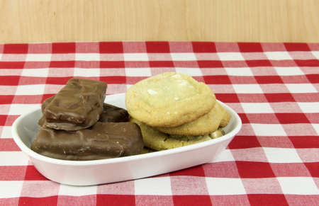 chocolate treats: Cookies and Chocolate treats on a red and white checkered table cloth Stock Photo