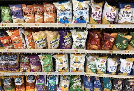 Spencer, Wisconsin,January,28,2018   Several bags of chips and snacks on a modern grocery store shelf