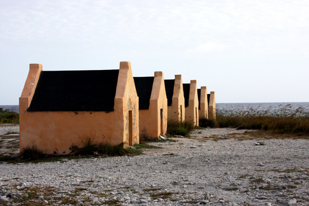 Slave huts built in 1850 for the slaves on the island of Bonaire decorate the historical beach