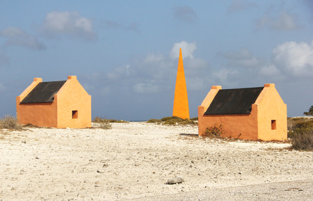 Bonairs Obelisks and Slave Huts on the shores of the island Stock Photo