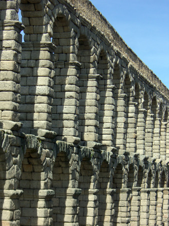 Ruins of the Roman Aqueducts against a blue sky
