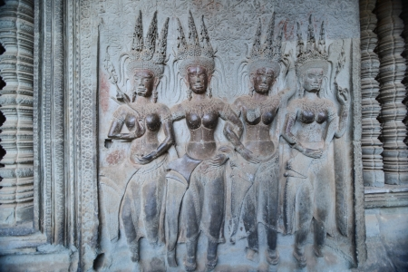 hindu god: Four dancing apsara on the wall in Angkor Wat, Siem Reap, Cambodia