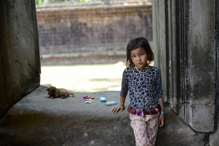 A taciturn girl at Angkor wat Temple, Siem Reap, Cambodia  photo
