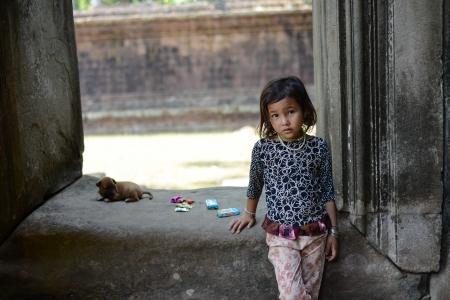 A taciturn girl at Angkor wat Temple, Siem Reap, Cambodia Stock Photo - 21319909