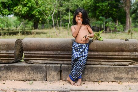 A boy of Relaxed posture at Angkor wat Temple, Siem Reap, Cambodia  photo