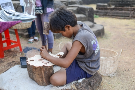 lonely child: A Child Labor at Angkor, Siem reap, Cambodia