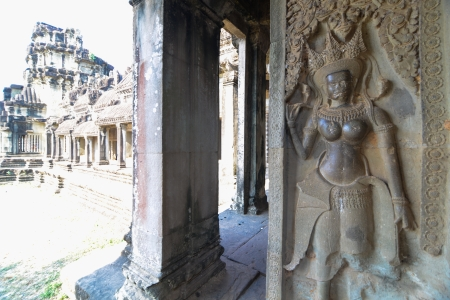 The corridor near apsara Relief statue in Cambodia Angkor Wat, Cambodia photo