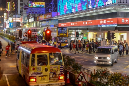 Hong Kong, China - January 01, 2014  Street Scene in Mongkok  Colorful shopping street Illuminated at night  Mongkok is a district in Hong Kong and has the highest population density in the world